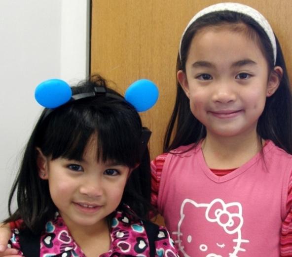 Cute sisters ears pierced at Rothsteins